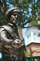 statue of sequoyah on nsu campus