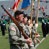 Image of rotc at football game.
